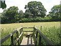TL2877 : Footbridge and stile at Broughton by M J Richardson
