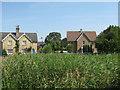 TL2985 : Ramsey, houses on Church Green by M J Richardson