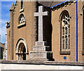 SX9473 : War Memorial Cross at St Michael's Church by David Dixon