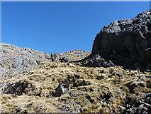 SH6358 : Rock outcrop and hillside above Llyn y Cwn by Richard Law