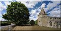 SK9725 : The church of St. Thomas of Canterbury: Churchyard tree by Bob Harvey