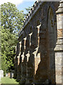 ST5561 : The buttresses on the north side of St Andrew's church by Neil Owen