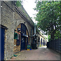 TQ3277 : Businesses under railway arches off Grosvenor Terrace, Walworth, south London by Robin Stott