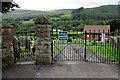SS9392 : Blaenogwr Cemetery gates in Nantymoel by Jaggery