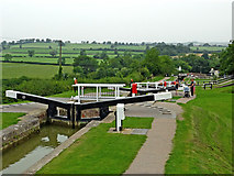 SP6989 : Staircase locks and farmland near Foxton in Leicestershire by Roger  Kidd