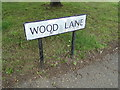 TL9326 : Wood Lane sign by Adrian Cable