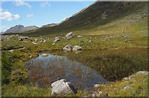 NG9458 : Lochan by the Coire Dubh Mòr path by Julian Paren