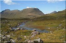 NG9359 : Lochan beside the Coire Dubh Mòr path by Julian Paren