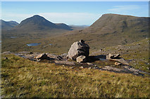 NG9361 : Boulder beside the path to Coire Mhic Fhearchair by Julian Paren