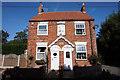 TA3723 : Coastguard Cottages, School Lane, Holmpton by Ian S