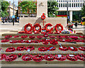SJ8398 : Tributes at the Cenotaph by David Dixon