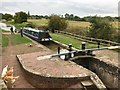 SJ6542 : Narrow boat entering lock by John Darch