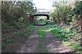 SK6033 : Track from Plumtree approaching Bridge 23 by Roger Templeman