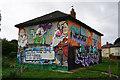 TA1330 : Vandalized street art on Wansford Avenue, Hull by Ian S