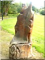 NH6066 : Carved seat in public park at Evanton by Oliver Dixon