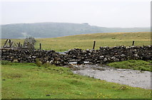 SD8965 : Dry stone wall over stream by Bill Harrison