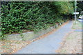 SP8988 : Wall and pavement beside Oakley Road approaching subway tunnel by Roger Templeman