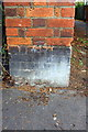 TL1897 : Benchmark on pier of wall bounding New Road cemetery by Roger Templeman