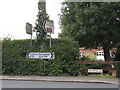 TL8528 : Roadsigns on the A1124 High Street by Geographer