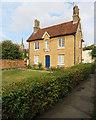 TL5338 : Saffron Walden: almshouse and spire by John Sutton