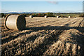 NN8808 : Stubble field and bales by Richard Sutcliffe