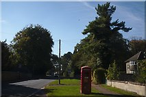 SK9805 : High street with Phone Box and Trees by Bob Harvey