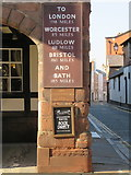 SJ4066 : Pied Bull coaching inn sign and a bench mark by John S Turner