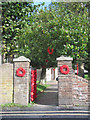 SP9211 : Poppy Wreaths at the side gate of Tring Church for Armistice Day by Chris Reynolds