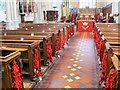 SP9211 : Poppies in the Nave of Tring Parish Church by Chris Reynolds