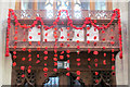 SP9211 : Poppies hang from the old screen in Tring Parish Church by Chris Reynolds
