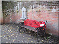 SP9211 : Seat (with poppy blanket) and water fountain in Tring HIgh Street by Chris Reynolds