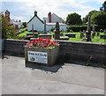 ST2583 : Flower tub near a Castleton corner by Jaggery