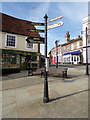 TL8130 : Signpost on the A131 High Street by Adrian Cable
