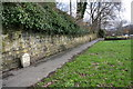 SE0026 : Milestone on pavement on NE side of Burnley Road by Roger Templeman