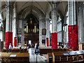 SP2864 : St Mary, Warwick - nave with poppies by Stephen Craven