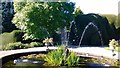NZ1221 : Raby Castle gardens - fountain and yew hedge by Michael Cooper