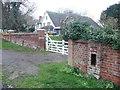 TL1032 : Derelict Edwardian letter box by Humphrey Bolton