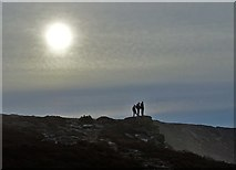 SK2781 : Walkers in milky sunshine on Burbage Edge by Neil Theasby