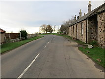 NT9529 : The junction of the B6351 with the A697 at Akeld by Peter Wood