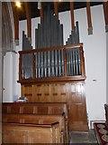 TQ0165 : Holy Trinity, Lyne: organ by Basher Eyre