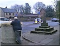 SK4856 : Tractor Spill at Kirkby Market Cross by Jonathan Clitheroe