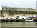 NZ8911 : Boats unloading at Whitby fish market by Stephen Craven