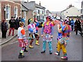 TL2797 : The multi-coloured menace of The Fens - Whittlesea Straw Bear Festival 2019 by Richard Humphrey