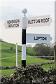 SD5579 : Old Direction Sign - Signpost by Newbiggin Lane, Hutton Roof Parish by Milestone Society