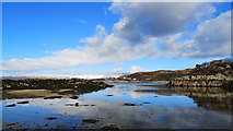 NG7527 : Sand and seaweed at a coastal cove on the Plock of Kyle by Julian Paren