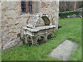 SJ0677 : Hooded tomb in the churchyard of Saints Mael and Sulien by Eirian Evans
