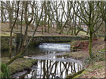 SD7009 : Small weir on the River Croal, Queens Park by Gary Rogers