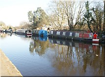 TQ1479 : View of narrowboats reflected in the Grand Union Canal at Three Bridges by Robert Lamb