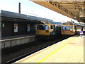 ST1875 : Two Class 142 trains in Cardiff Central station by Jaggery