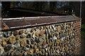 TL4845 : Churchyard wall by Bob Harvey